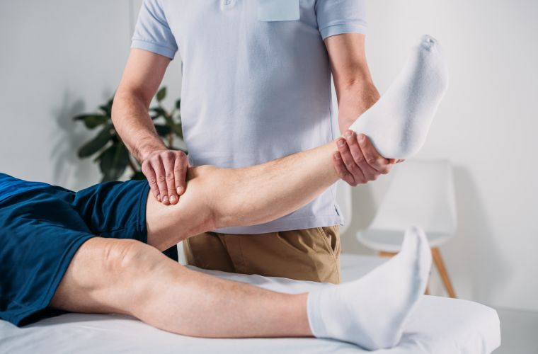 physio treating man's knee